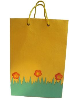 Handmade paper bag with gold screen printing.
